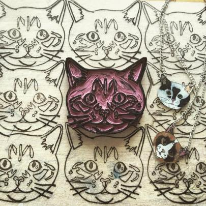 Rachel McKay. Fat Cat Society Linoleum stamp prints and shrinky dink necklaces